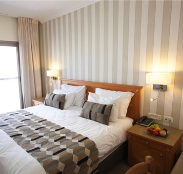 מלון ארמון הירקון - חדרים